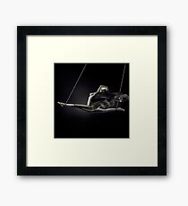 Nude woman swinging in splits in the air with bondage rope and flowing cloth around her naked body art print Framed Print