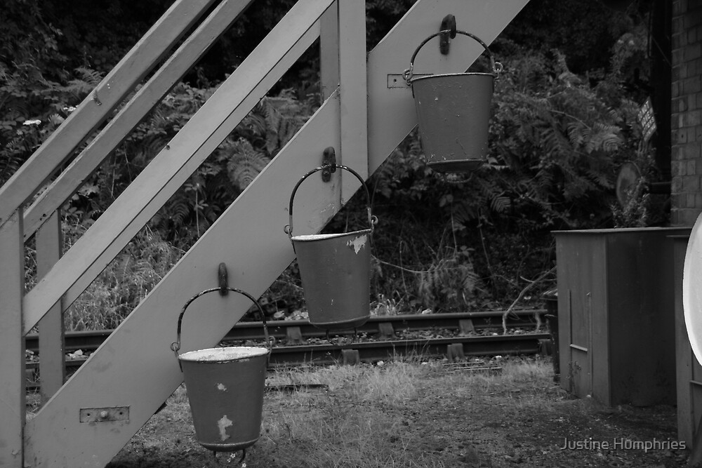 Fire buckets in black & white by Justine Humphries
