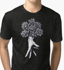 Hand with lotuses on black Vintage T-Shirt