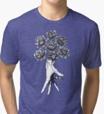 Hand with lotuses on black Tri-blend T-Shirt