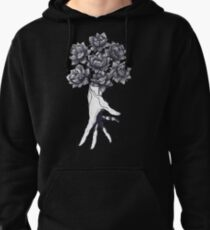 Hand with lotuses on black Pullover Hoodie
