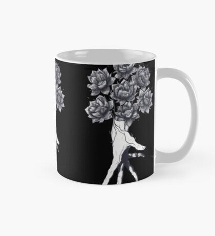 Hand with lotuses on black Mug