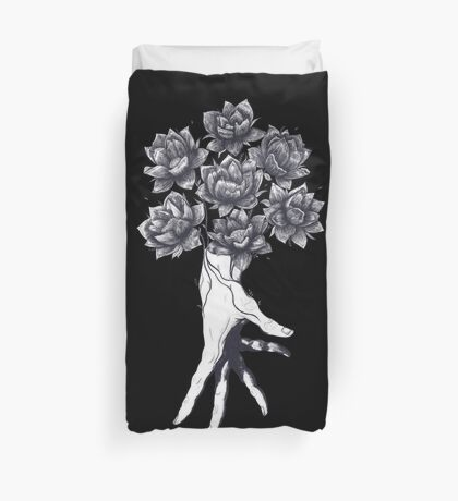 Hand with lotuses on black Duvet Cover