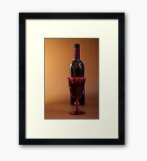 full glass of red wine Framed Print