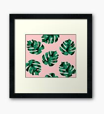 Tropical fern leaves on peach Framed Print
