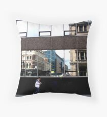 lone figure in City Throw Pillow