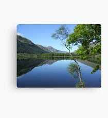 mirror calm scottish loch   Canvas Print