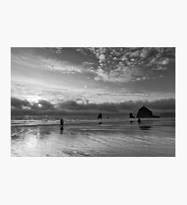 People walking on the beach at sunset Photographic Print