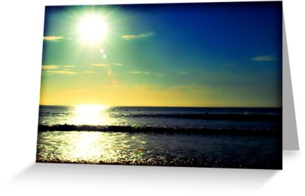 Surfing at sunrise by Nicole Goggins