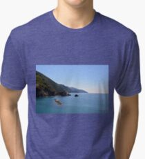 The beautiful landscape of Portofino  Italy with the blue water and the cliff shore Tri-blend T-Shirt