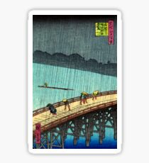 Pedestrians crossing a bridge during a rain storm - Hiroshige Ando - 1857 Sticker