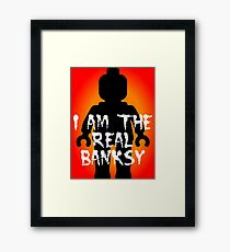 "Black Minifig with ""I am the Real Banksy"" slogan, Customize My Minifig Framed Print"