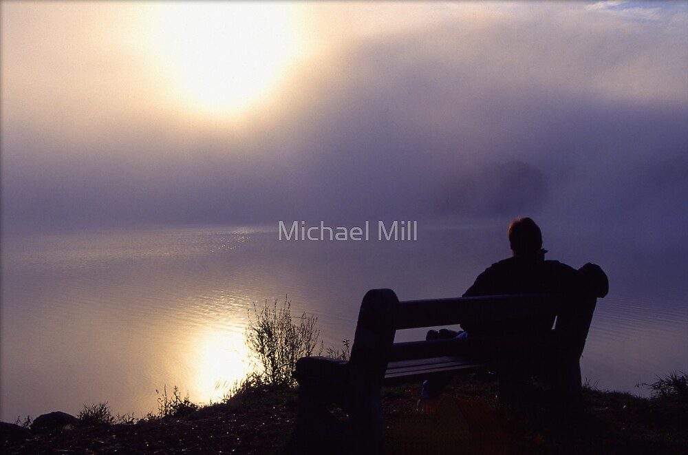 Man Enjoys Peaceful Morning by the Lake by Michael Mill