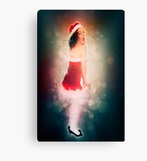 Young sexy woman in a red corset wearing Santa hat on white background Canvas Print