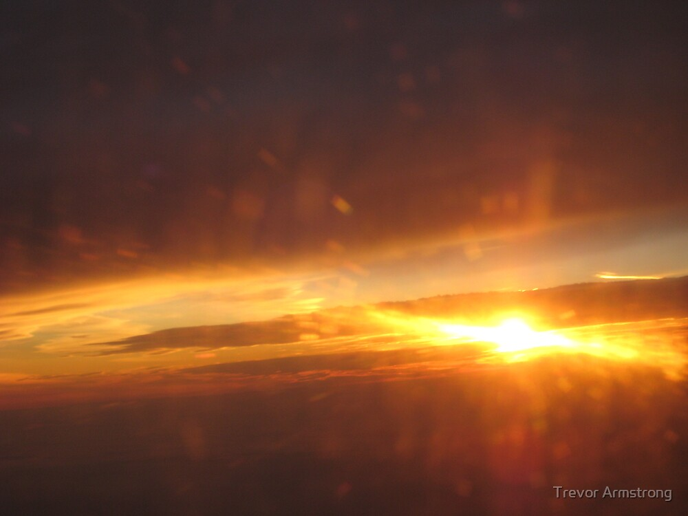 Sunset on flight home by Trevor Armstrong