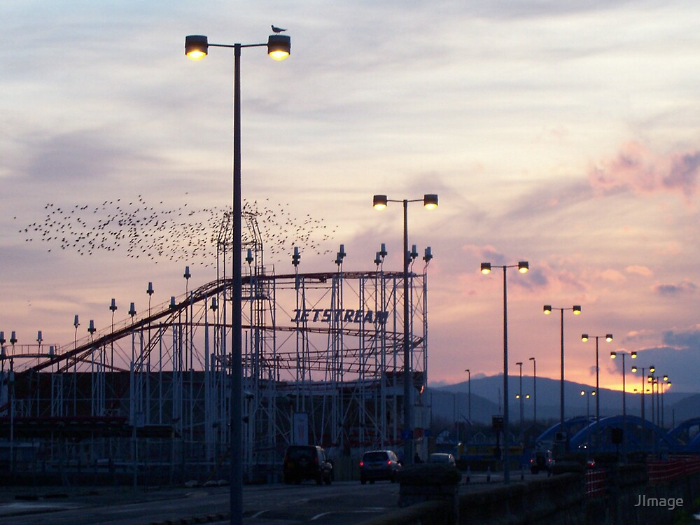 Starlings over the Funfair by JImage