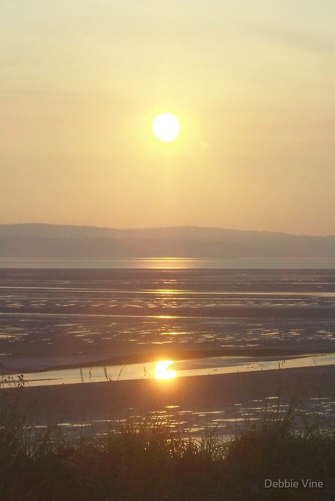 Sun setting at Thurstaston by Debbie Vine