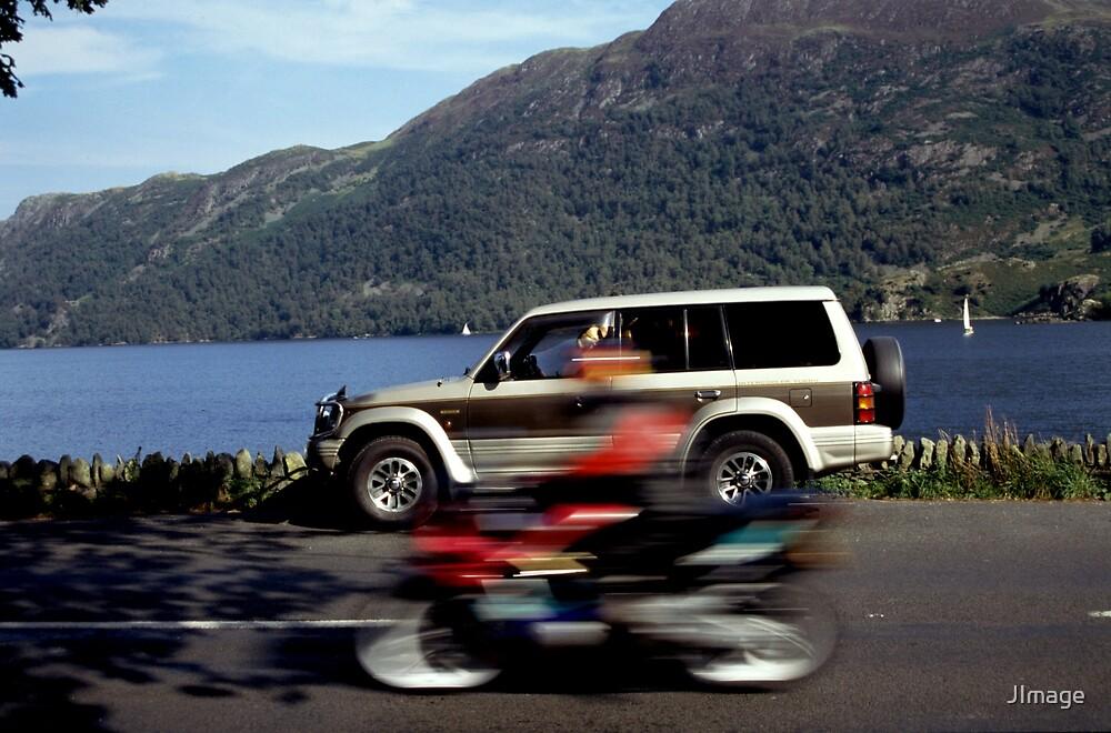 Passing Biker by JImage