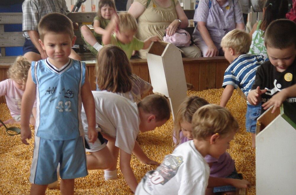 STATE FAIR VIRGINIA CHILDREN PLAYING IN CORN by sky2007