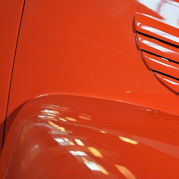 Detail of orange shining car hood by oanaunciuleanu