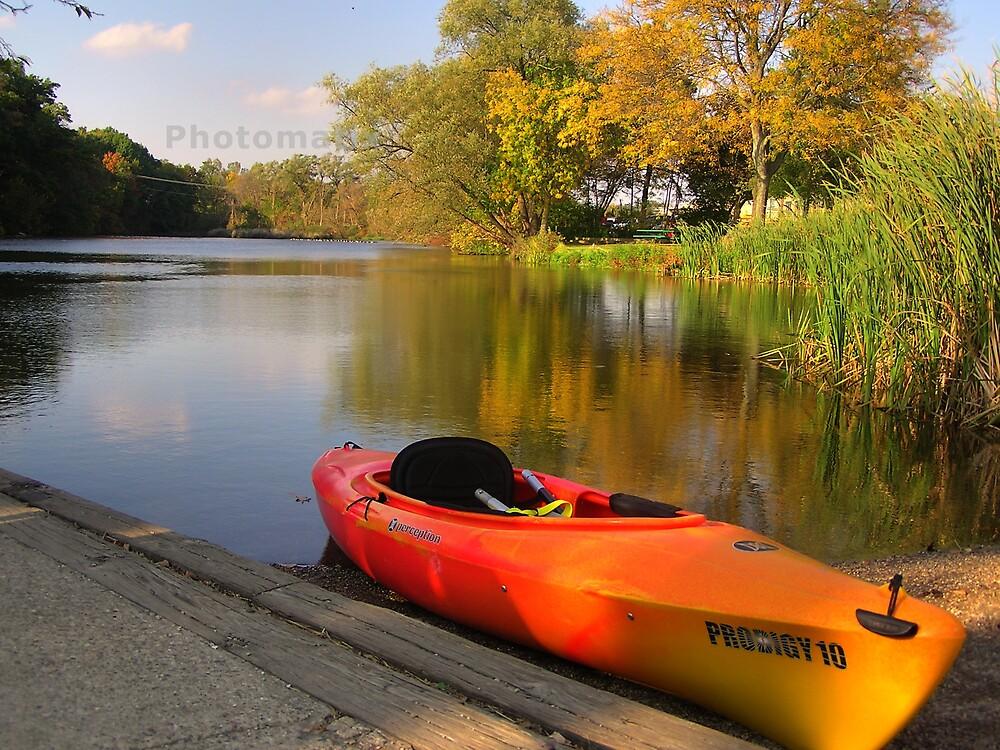 kayak docked at riverside by Kerri Kenel