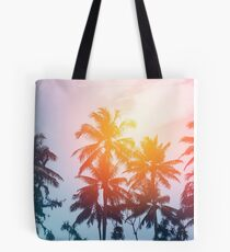 Beach sunset at the coast line Tote Bag