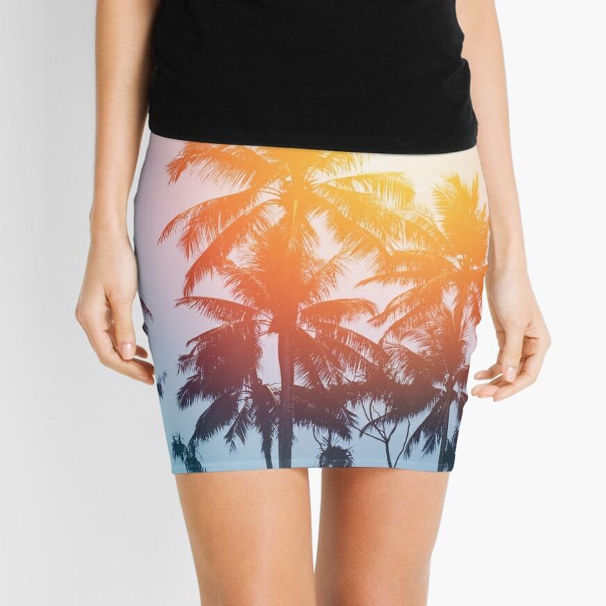 Beach sunset at the coast line Mini Skirt