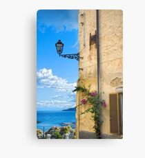 House with bougainvillea, street lamp and distant sea Metal Print