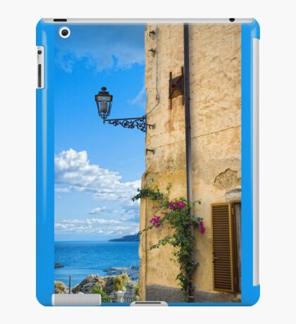 House with bougainvillea, street lamp and distant sea iPad Case/Skin