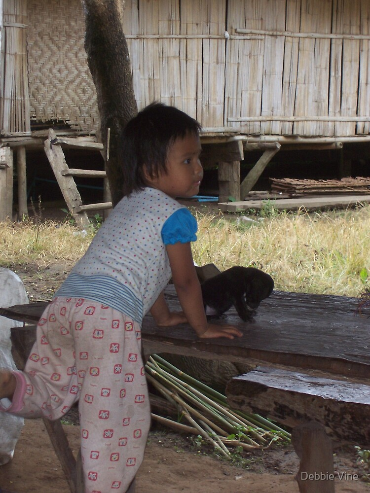 Thai girl in village by Debbie Vine