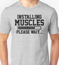 INSTALLING MUSCLES PLEASE WAIT... Unisex T-Shirt