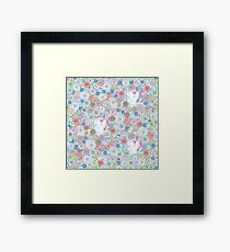 White cats hiding in the flowers Framed Print