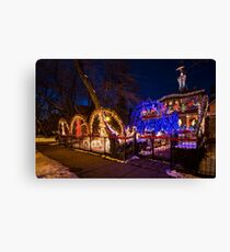 Crazy amount of xmas lights on this house Canvas Print