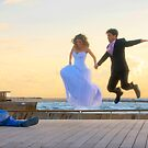 Jump of joy! A couple about to get married, is photographed at the Tel Aviv Marina, Israel by Eyal Nahmias