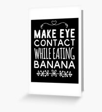 Make eye contact while eating banana Greeting Card