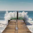 Crashing waves against a pier in Portugal by SteveHphotos