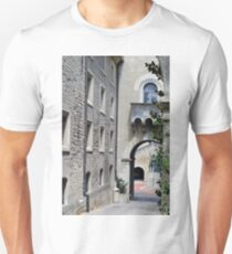 Street with stone buildings and arches in San Marino T-Shirt