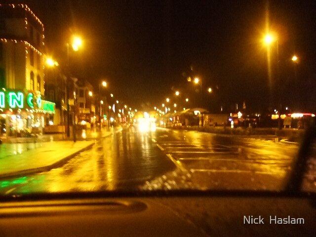 wet road by Nick  Haslam