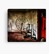 Spinning wheel and a chair Canvas Print
