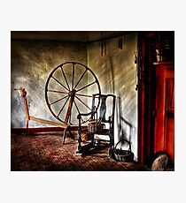 Spinning wheel and a chair Photographic Print