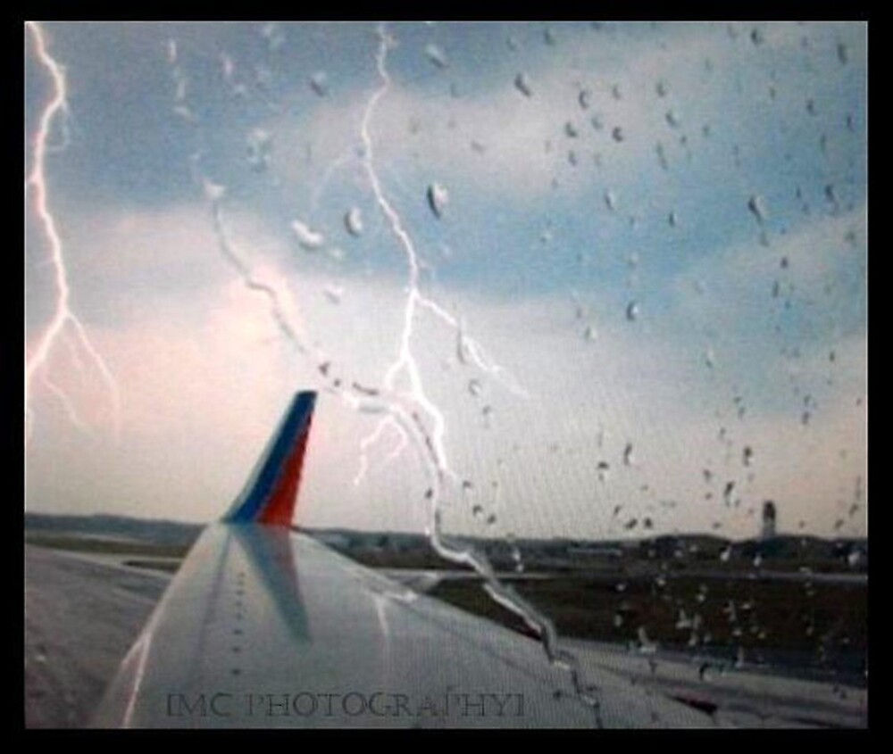 Lightning on the plane.. by Melissa  Carroll