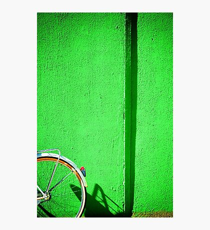 Bicycle wheel and green wall Photographic Print
