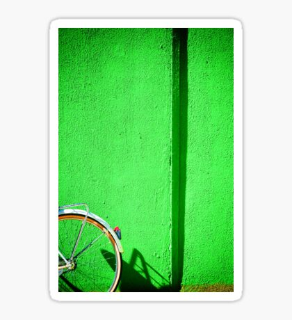 Bicycle wheel and green wall Sticker