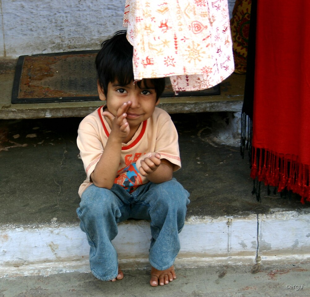 014 little boy sitting in front of the father's shop by sergu