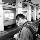Level-up on the subway, Tokyo, Japan by Norman Repacholi