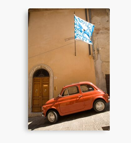 Old Fiat parked in Montepulciano street Canvas Print