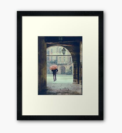 Man with umbrella on a snowy day Framed Print