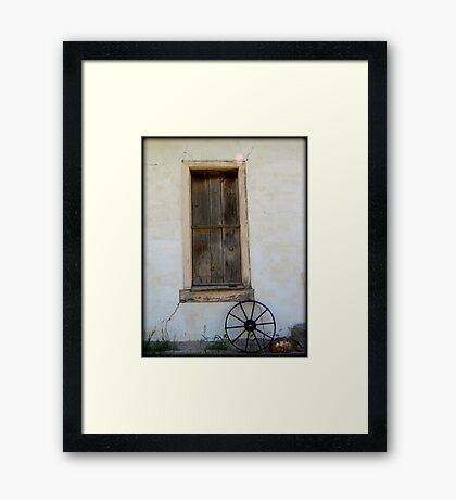 Wagon Wheel by window Framed Print