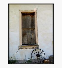 Wagon Wheel by window Photographic Print