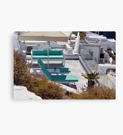 Terrace with sun beds in Santorini, Greece Canvas Print
